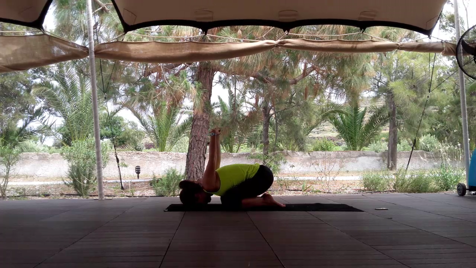 Version Balasana.Open you chest and rotate your shoulder blades back.